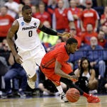 Dayton's Scoochie Smith reverses direction in front of Providence's Ben Bentil (0) in the second half of an NCAA tournament college basketball game in the Round of 64 on Saturday in Columbus, Ohio.