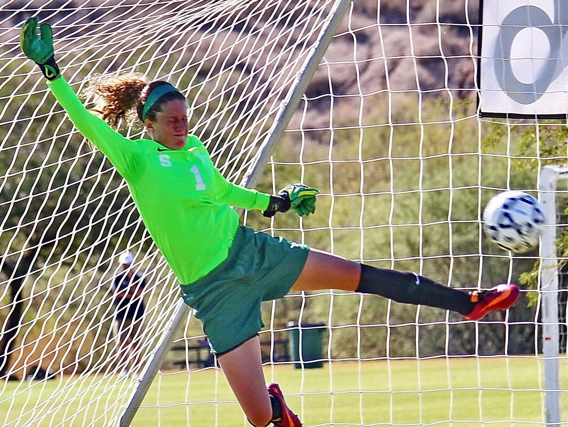 Former North Farmington standout Katie Foss makes a save for the MSU women's club team.