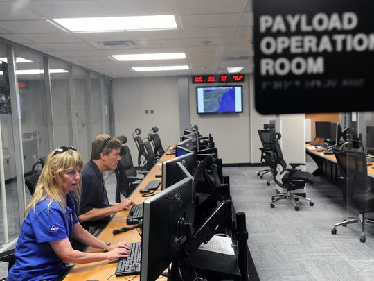 HS3 Project Manager Marilyn Vasques and HS3 Deputy Project Scientist Paul Newman track operations in the payload operations room at Wallops Flight Facility on Thursday.