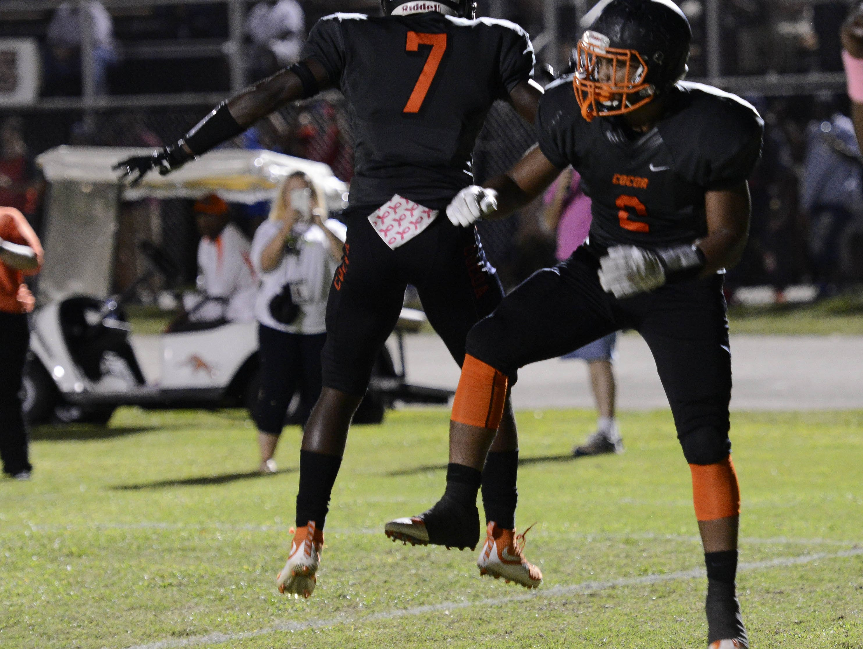 Timmy Pratt (2) and Juwan Armstrong of Cocoa celebrate a Pratt TD during Friday's game against Cocoa.