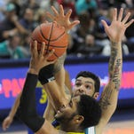 UNCW forward Marcus Bryan defends against Delaware's Maurice Jeffers on Thursday at Trask Coliseum.
