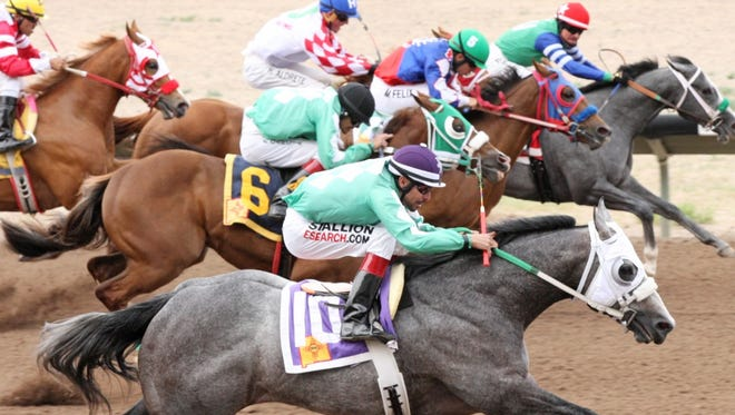 On the far outside, A Super Sonic Boom and jockey Jaime Leos outdueled Frost Dalena, ridden by Alejandro Medellin (inside) and prevailed by a neck to win Sunday's $101,680 New Mexico Breeders' Futurity at SunRay Park and Casino in Farmington.