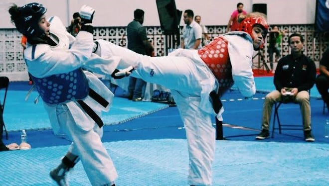 Oxnard's Taylor Ramirez, 19, right, won a gold medal at the Amateur Athletic Union National Taekwondo Championships.