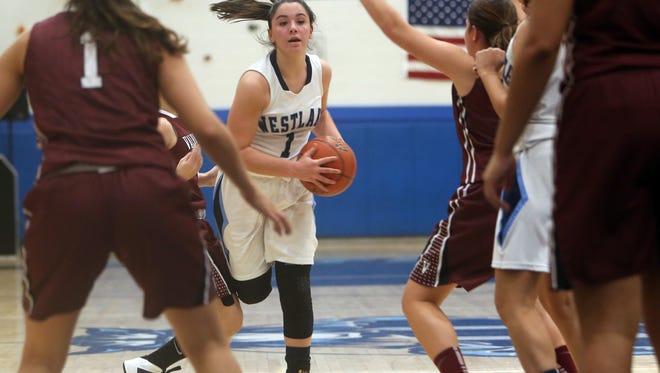Westlake and Valhalla in girls basketball action at Westlake High School in Thornwood Dec. 4, 2015. Valhalla won the game 66-57.