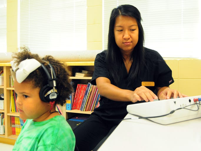 Southern Miss graduate student Mercedes Le gives Trinity Taylor, 5, a hearing exam Thursday morning at Petal Primary School during the annual Kid's Health Fair. The fair provided free health screenings, free immunizations and other services for children up to 12 years old.