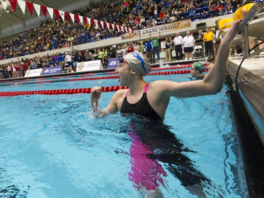 Carmel's Amy Bilquist reacts as she looks at the team's time in the 200 Yard IM Relay, Feb. 14, 2015, at IUPUI Natatorium in Indianapolis.