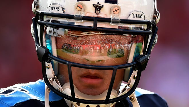 The field is reflected in the safety shield on quarterback Marcus Mariota's helmet.