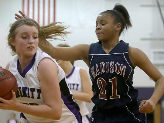 Madison Academic's Akia Stovall (21) plays defense in a January game against Trinity Christian Academy.