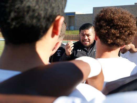 New Rochelle head coach Jarohan Garcia talks to his