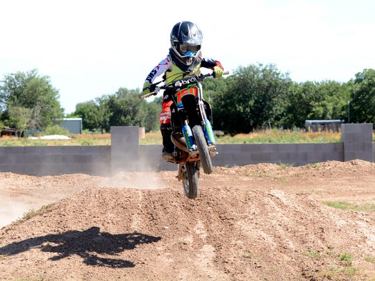 Jake Willis, 7, works on his jumps at his makeshift training course at his home on Wednesday.