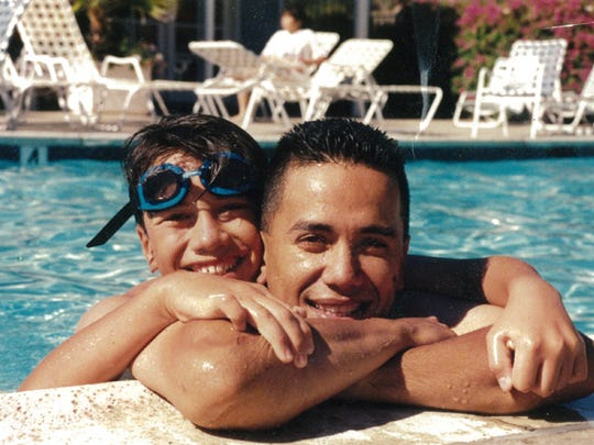 Mark Torre and his son, Mark ÒMarkyÓ Torre Jr., are shown in this 1993 family photo taken in San Diego. 