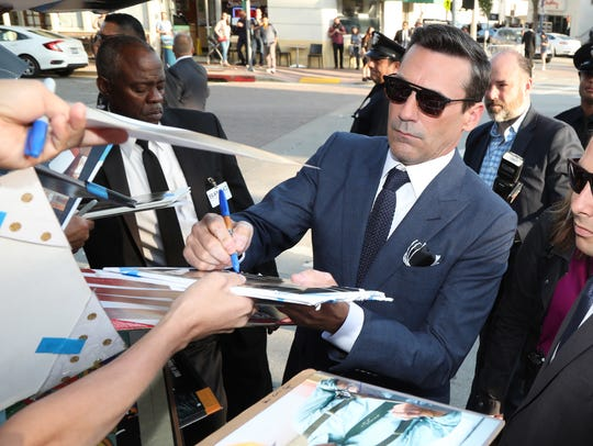Looking very Don Draper, Jon Hamm signs autographs