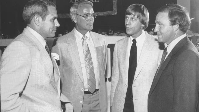 """Ken Hatfield (Left), head football coach at the University of Arkansas, speaks with (From Left) Ken Netherland, of Class """"AAA"""" Germantown High School, Danny Mathis of Class """"AA"""" Kirby High School and Jimmy Heinz of Class """"A"""" Evangelical Christian School at the Best of The Preps awards banquet on 14 May 1984.  Hatfield was the featured speaker and the other coaches were named Male Sports Coach of the Year in their respective divisions."""