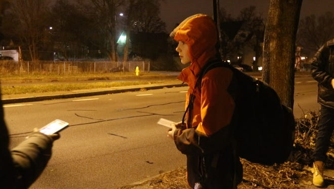 Linden Burack gets his bus pass ready as the bus starts to pull up to the stop on Ford Street.