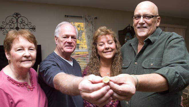 Barbara and Norman Floyd, left, met up with Cheryl and Mike Walsh after Norman Floyd discovered the wedding ring lost by cancer patient Mike Walsh at a Costco. Norman Floyd found it near the sidewalk outside the store, but didn't know who lost it until returning from vacation to read an article about it.