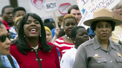 Congresswomen Terri Sewell marches in a commemorative march of the 1965 Selma to Montgomery March with others as part of the National Parks Service 50th Anniversary Walking Classroom in Montgomery, Ala., on Wednesday, March 25, 2015.