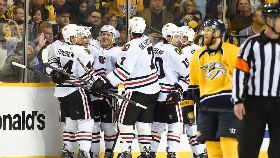 Blackhawks players — six of them — celebrate after