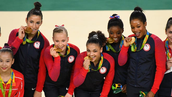 Team USA celebrates winning gold medals during the women's team finals in the Rio 2016 Summer Olympic Games at Rio Olympic Arena.