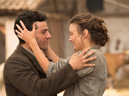 Oscar Isaac and Charlotte Le Bon in a scene from 'The Promise.'