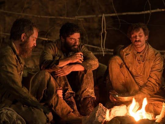 Oscar Isaac (center) in a scene from 'The Promise.'