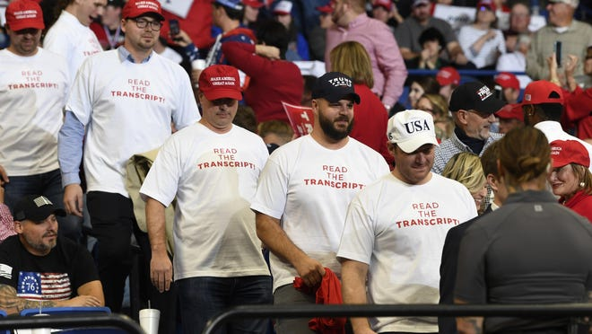 "In this Nov. 4, 2019, photo, people wearing shirts with the words ""Read the Transcript"" arrive to attend a campaign rally with President Donald Trump in Lexington, Ky. (AP Photo/Susan Walsh)"