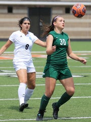 Novi's Bailey Baumbick (right) maintains possession in front of Stevenson's Yasmine Jaafar.