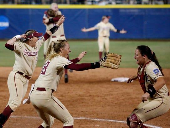Florida State players celebrate after defeating Washington