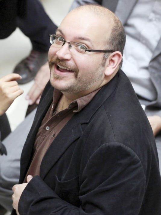Jason Rezaian, an Iranian-American correspondent for the Washington Post, smiles as he attends a presidential campaign of President Hassan Rouhani in Tehran, Iran on April 11, 2013.