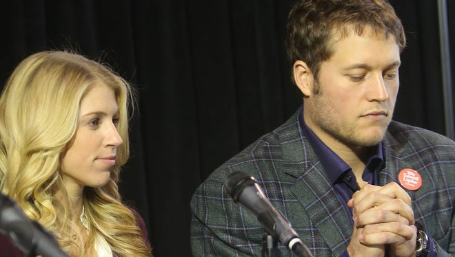 Detroit Lions quarterback Matthew Stafford, right, and fiancee Kelly Hall listen to a plan to reopen the shuttered Lipke Recreation Center in Detroit on Jan. 27, 2015.