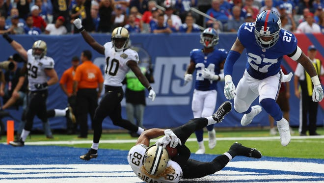 Willie Snead IV #83 of the New Orleans Saints scores a touchdown against  Darian Thompson #27 of the New York Giants during the fourth quarter at MetLife Stadium on September 18, 2016 in East Rutherford, New Jersey.