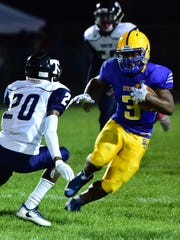 RU's Isaac Grant puts a move on Thurston's Keion Harris Friday night.