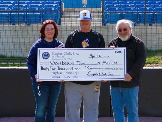 Waynesboro coach Greg Chandler accepts the check presented