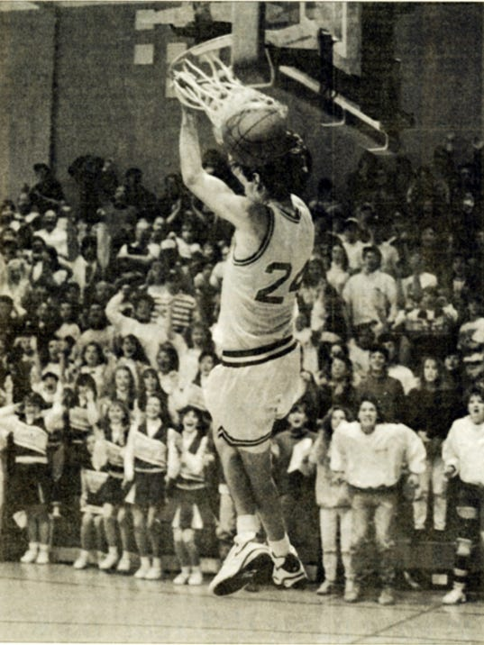 Kennard-Dale's Adam Miller slams home career points No. 2,000 and 2,001 to the delight of the Kennard-Dale fans during the 1992-93 season. At the time, Miller was the second boys' basketball player to reach 2,000 career points. West York's Travis Hoffman was the one who threw Miller the pass.