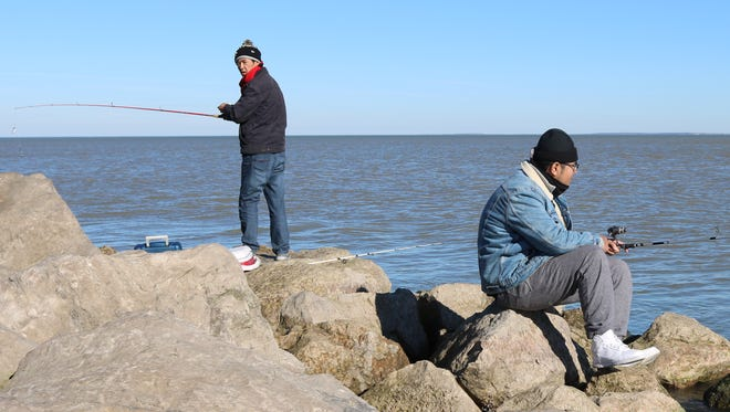 Tiemin and Zicheng Zhao, both of Cincinnati, drove up to Port Clinton to take advantage of the unseasonably warm weather and do some fishing.