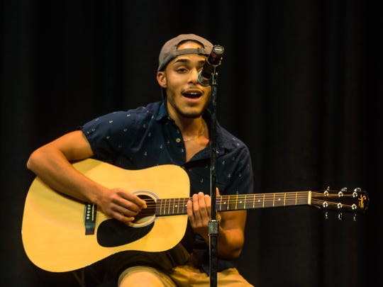 Elvyn Robles performs 'Two Lips' during the talent portion of Mr. Vineland at Vineland High School on Thursday, January 11.