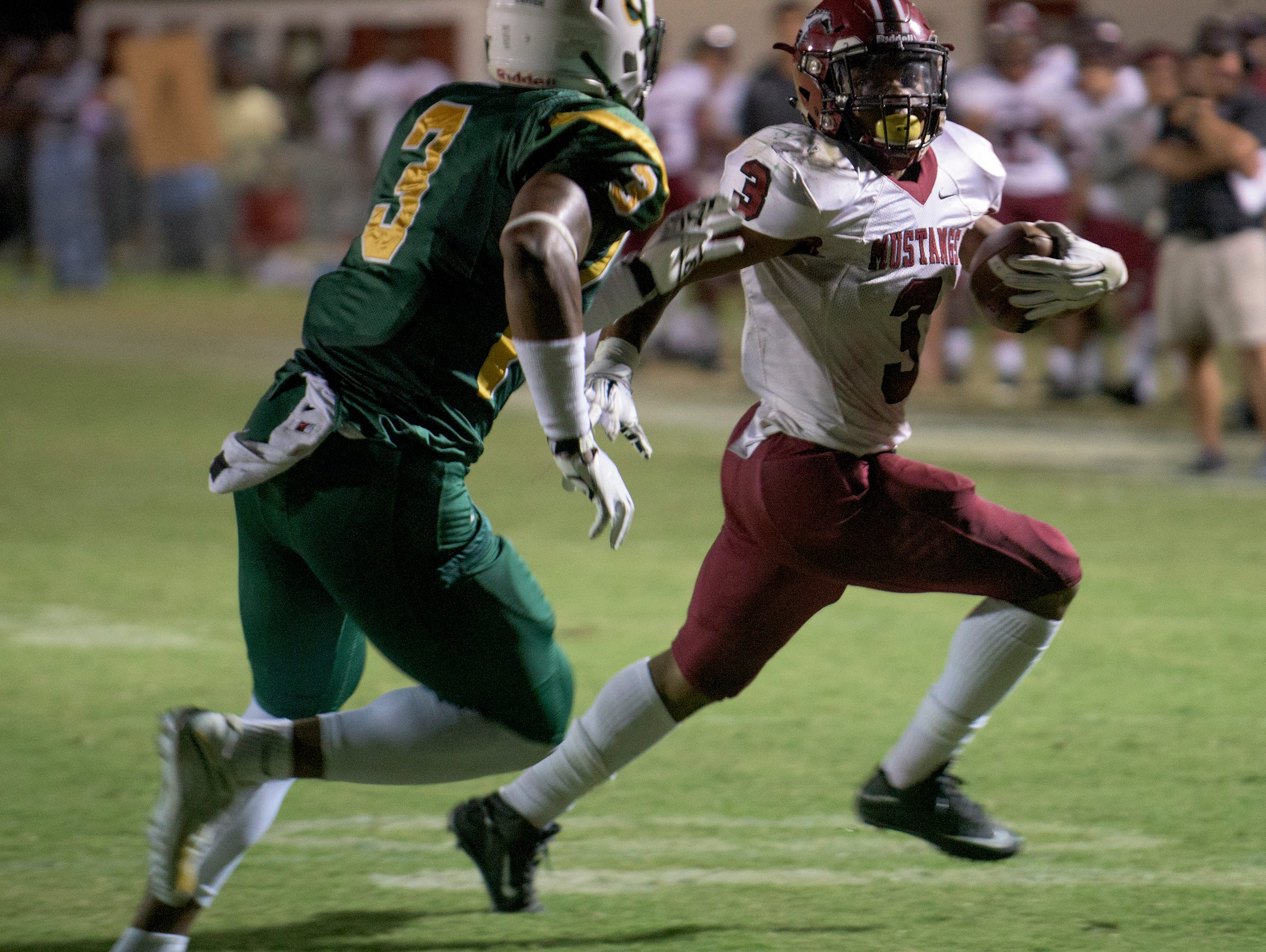 Stanhope Elmore's Bennie Smith tries to get by Carver's Lyndell Wilson in Millbrook, Ala. on Friday September 18, 2015.
