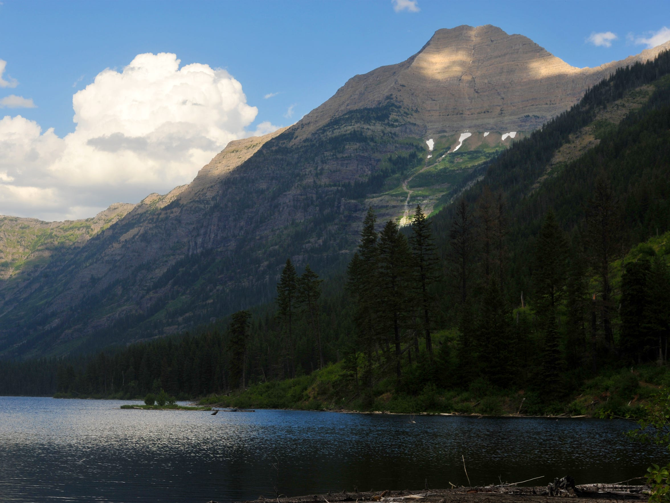 Heavens Peak overlooks Trout Lake in Glacier National
