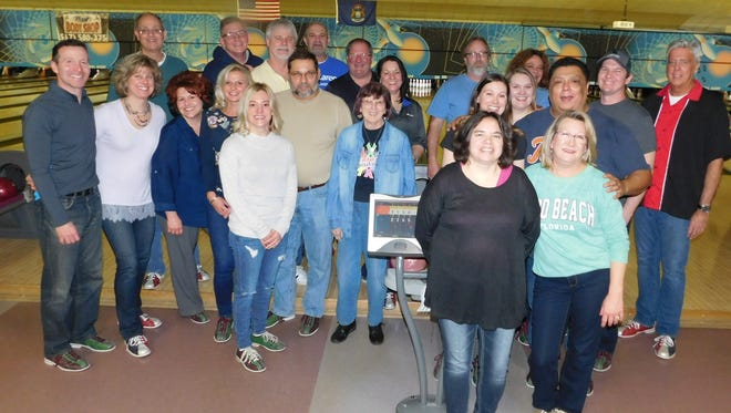 Bowlers at the Leroy Chain Cancer Bowl pose for a photo after an afternoon of fun supporting the McLaren Greater Lansing Foundation.