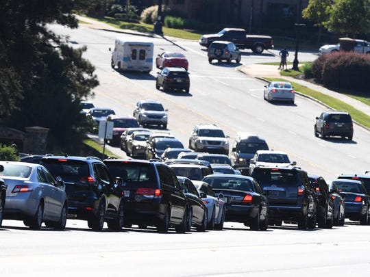 Lines of vehicles back up on Verdae Boulevard in Greenville near the Embassy Suites hotel where President Donald Trump was scheduled to speak on Monday, Oct. 16, 2017.