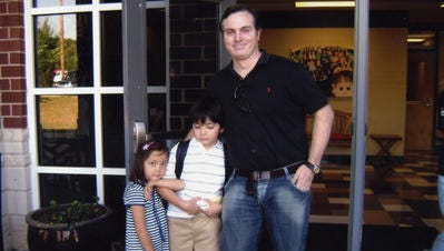 Christopher Savoie with his kids, Rebecca and Isaac, at the first day of school in 2008 at Winstead Elementary in Franklin