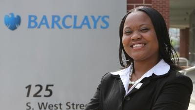 Delaware State student Tiona Campbell stands outside the Barclay's Bank building in Wilmington.