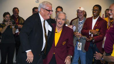 Bob Breunig, left, a new member of the College Football Hall of Fame greets his former ASU coach Frank Kush on Friday at a Legends Luncheon.