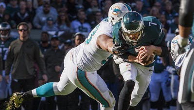 Eagles quarterback Sam Bradford is sacked by Miami's Ndamukong Suh in the second quarter during the Eagles' loss on Sunday.