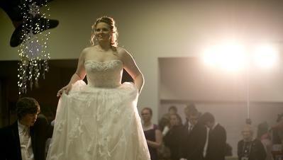 Dawn Wolf of Chili models a wedding dress during the 33rd annual Bridal Fair Extravaganza at the Marshfield Mall.