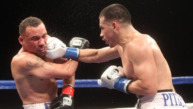 FILE - Frankie Gomez (right) lands a right to Vernon Paris at Fantasy Springs Resort and Casino.