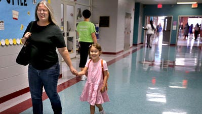The Murfreesboro City Council will be voting on funding a 10-classroom expansion of Black Fox Elementary School. In this file photo, Elizabeth Crawford, walks her daughter Isabelle Crawford to her first-grade classroom on the first day of school at Black Fox Elementary, on Wednesday, August 5, 2015.