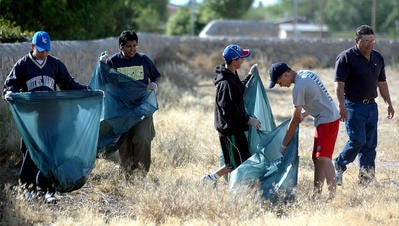Members of a summer league basketball team lend a hand in this file photo from the 2012 Great American Cleanup.