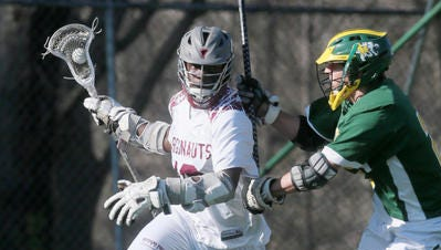Rutgers Prep's Tre Allen (18) is defended by North Hunterdon's John Capezzuto (20) on Wednesday.