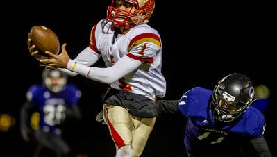 Edison's Justin Turner makes a reception in front of Old Bridge's TJ Angstadt during the first quarter of their Central Group V playoff game at Lombardi Field in Old Bridge on Friday Nov. 13, 2015.