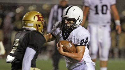 Bridgewater-Raritan's David Usewick carries the ball against Hillsborough last season.
